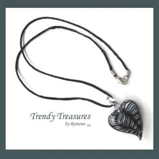 when you wear this beautiful black white swirl puffed glass heart