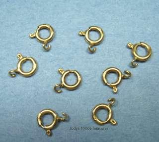 14K SOLID GOLD SPRING RING 6.5mm. AVERAGE 0.25gr. 585