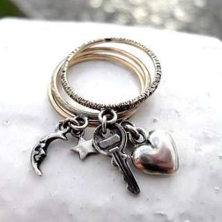 to my heart charm ring made from 9ct yellow gold with silver charms