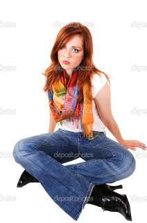 An pretty and tall teenager with bright red hair and colored scarf