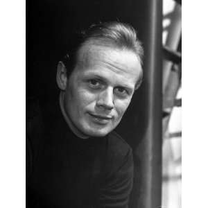 Actor Richard Widmark Posing for a Picture Stretched